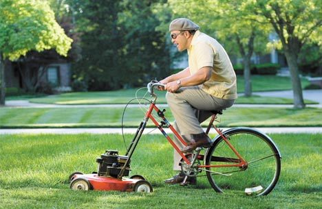 guy-riding-bicycle-lawnmower.jpg